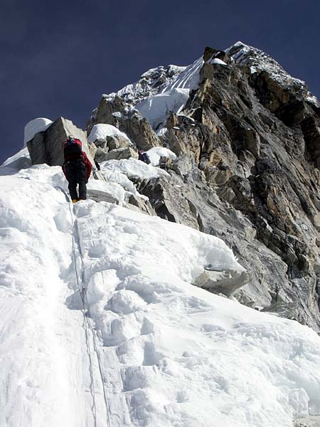 Climber on the upper ridge of Ama Dablam (photo: Justin Merle)