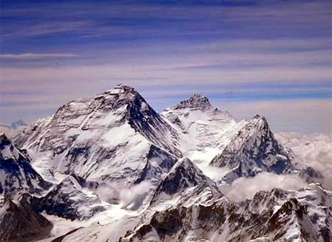 Mount Everest viewed from the summit of Cho Oyu. The Northeast ridge runs along the left skyline with the North Ridge dropping off toward the North Col and Changtse about half way down. The Western Cwm, South Col, and Southeast ridge are visible to the right, as well as Lhotse and Nuptse. (IMG Stock Photo taken by Craig John)
