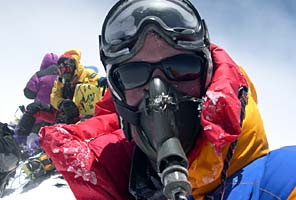 International Mountain Guides climbers on the summit of Everest