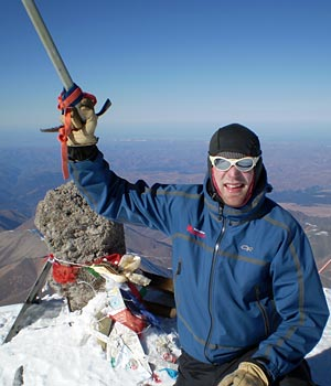 IMG Guide Mike Hamill on the summit of Mt. Elbrus in Russia