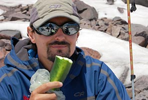 IMG guide Max Bunce enjoys a cucumber snack on Mt. Rainier