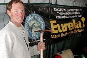 Tap Richards with an ice axe relic found from an early Chinese climb on the North Side of Everest