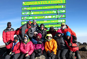 International Mountain Guides climbers on the summit of Kilimanjaro Africa