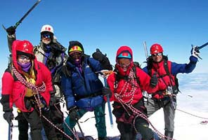 International Mountain Guides climbers on the summit of Mt Rainier