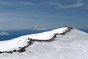 The summit crater of Mt. Rainier with International Mountain Guides