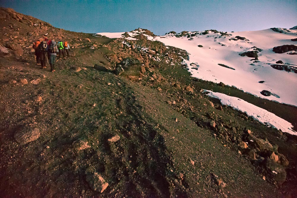 Kili climbers approaching 19,000' on Kili before the sun breaks over the horizon. (Photo by Adam Angel)