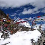 Prayer flags strung across mountain pass in Bhutan (photo: Karl Lundgren)