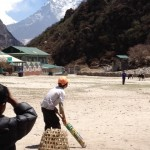 Sherpa children playing cricket.