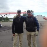 Mike and Greg pass each other in the international terminal at Talkeetna Air Taxi
