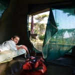Owen catching up on some reading at the end of the day in one of the safari tents (Eben Reckord)