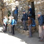 The team hearing about the Aztec ruins. (Greg Vernovage)