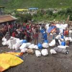 Sorting porter loads in Sama (Phunuru Sherpa)