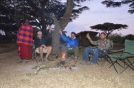 Hanging out at the safari camp with the their Maasai camp guard