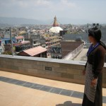 Tsering Dolkar shows off the view to Boudhanath from the rooftop of her new Hotel Tibet International.  (Eric Simonson)