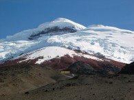 Cotopaxi. Note the hut with the yellow roof.