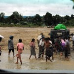 Sometimes it takes a village - villagers pushing our jeep through a river! (photo: Jenni Fogle)