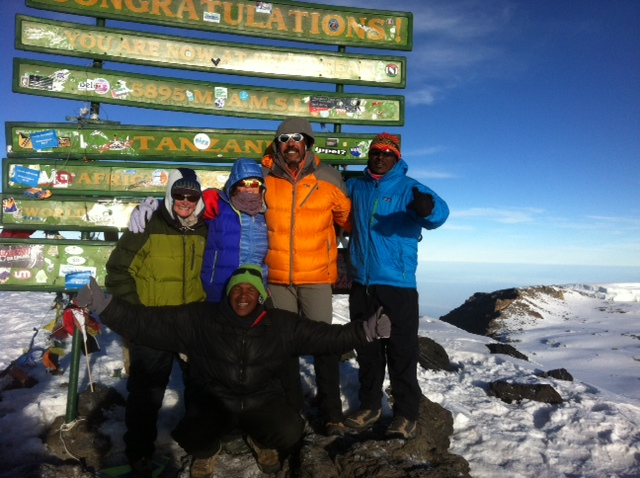 "The new and ""improved"" sign at the top of Uhuru Peak (Max Bunce)"