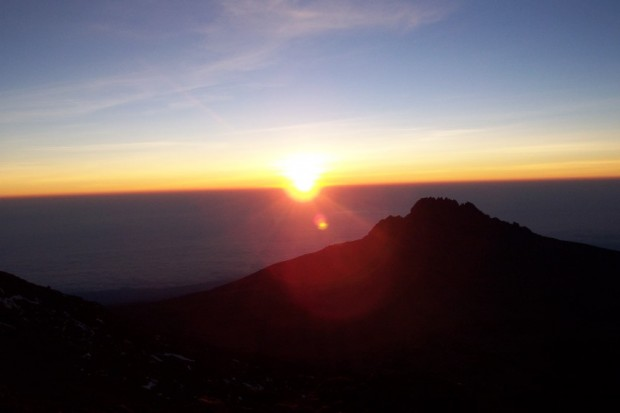 Sunrise over Mawenzi peak, on the way to the summit of Kilimanjaro  (Eric Simonson)
