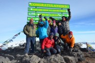 "The new and ""improved"" sign at the top of Uhuru Peak (Eben Reckord)"