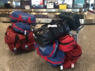 Team baggage arrives at the Anchorage airport (Dallas Glass)