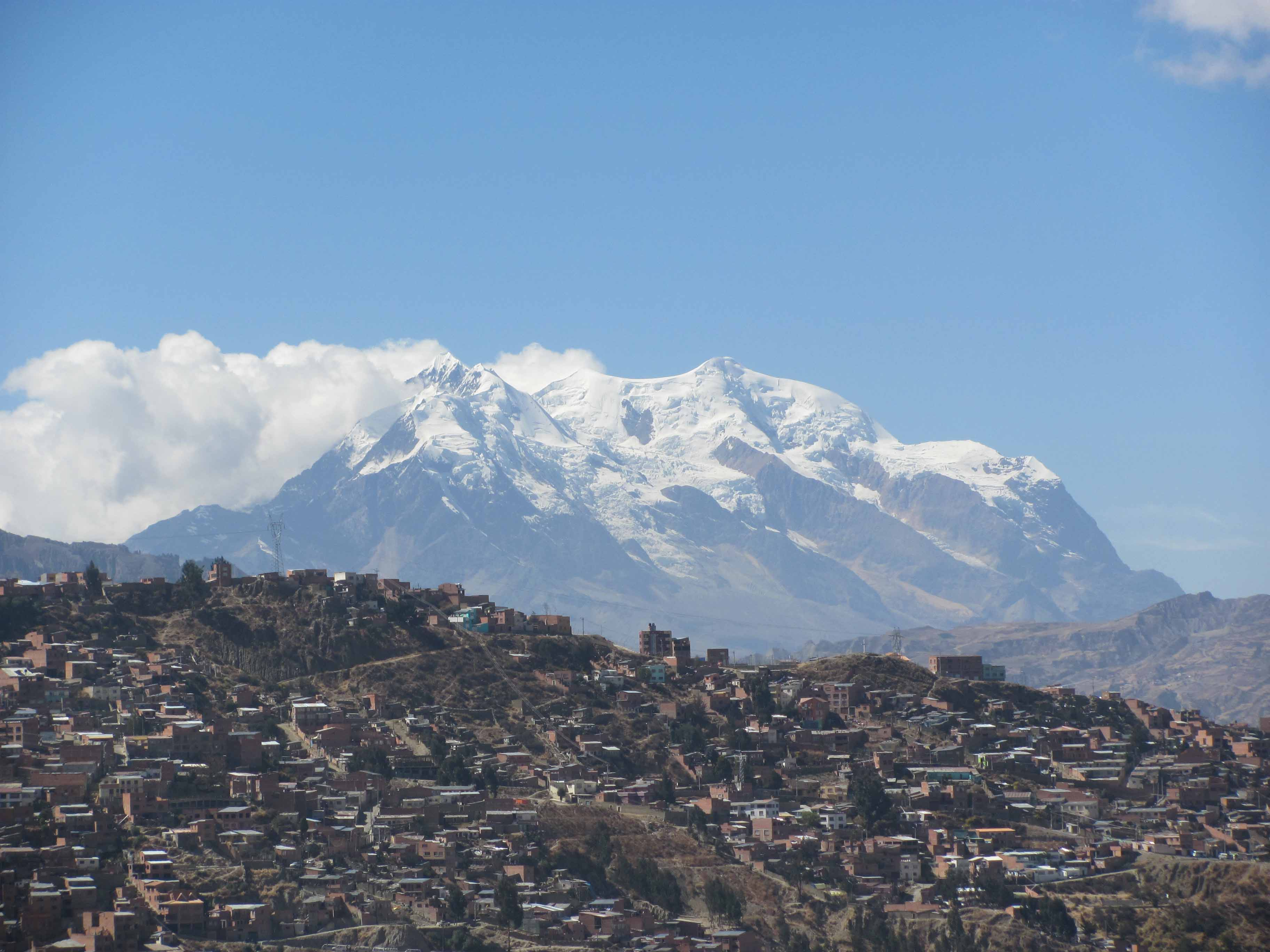 Illimani is just plain big!  Over 21,000 feet high, the mountain towers 9000 feet above La Paz, about 25 miles away.  (Greg Vernovage)