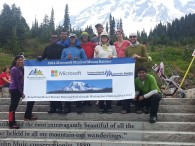 The team on the steps at Paradise. All Smiles after a summit!