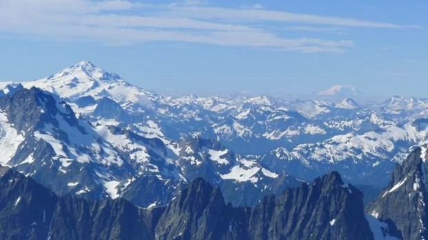 Glacier Peak and Mount Rainier from up high on Forbidden Peak. (Photo by Eric Remza)