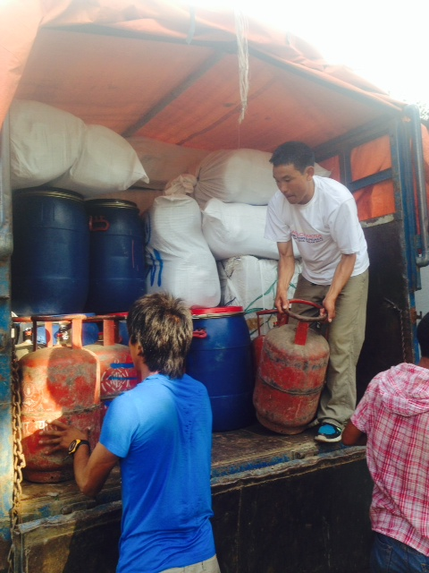 Cho Oyu Sherpas load the truck in Kathmandu for another adventure to Tibet (Ang Jangbu Sherpa)