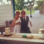 Josh and Jessica Tapp cutting the cake.