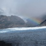 A rainbow over grey glacier. (Photo by Tye Chapman)