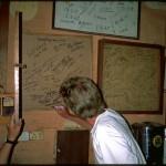 George signs Rum Doodle Everest board 1991