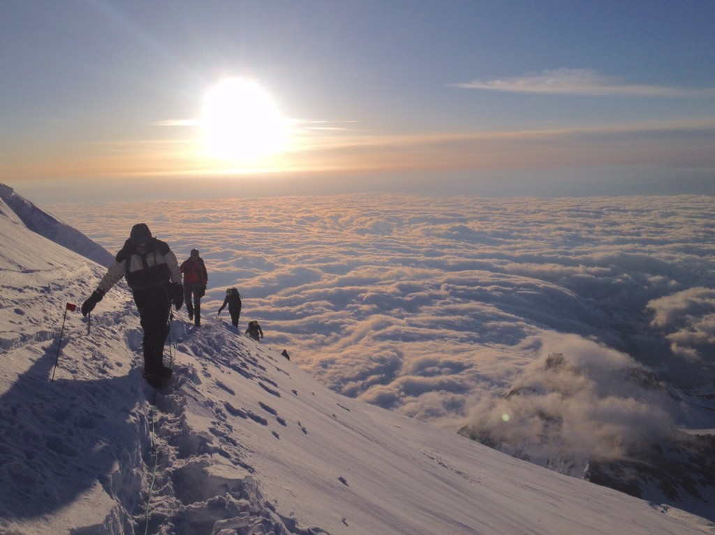 An IMG rope team on one of the final pushes to the summit of Mt. Rainer. (Photo by IMG Guide Chris Meder)