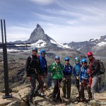 The team poses on top of the Rifflehorn with the Matterhorn in the background. (Liz Smart)