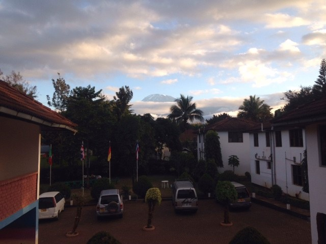 Kilimanjaro over the clouds from the hotel in Moshi. (Dustin Balderach)