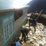 Rebuilding damaged wall in Phortse (Phunuru Sherpa)