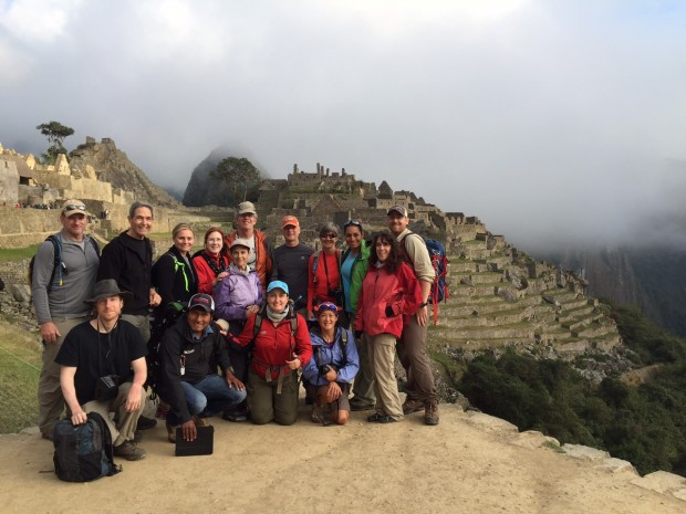 The team poses in front of the ruins of Machu Picchu