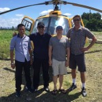 Greg and the Indonesian team with the AS 350B3 helicopter in Timika