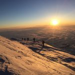 Guide Dustin Balderach's rope team at sunrise (Nate Sievert)