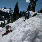 Lowering a rescue sled in steep terrain