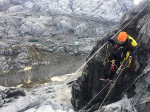 On the tyrolean traverse with Yellow Valley BC below. (Jonathan Schrock)