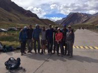 Team at the trailhead with the south face of Aconcagua - 'in the rear view mirror' -