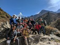 Team Photo with Ama Dablam behind. Ang Pasang is at the lower left of the photo. (Harry Hamlin)