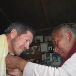 IMG Partner Phil Ershler being blessed by Lama Geshe. (Greg Vernovage)