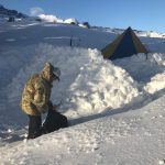 Snow Walls Protect the Cook Tent from Harsh Winds (Conrad Wharton)