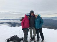 Luke and a smiling rope team on the summit of Cayambe