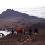Last steps to Stella Point with Mawenzi in the background_(Eric Simonson)