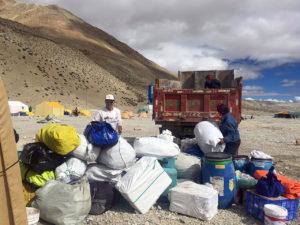 PK Sherpa unloading gear at Gyaplung (Phunuru Sherpa)