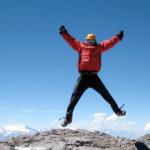 IMG climber celebrates on the summit of Aconcagua (Ben Kurdt)