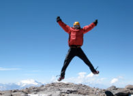 IMG climber celebrates on the summit of Aconcagua (Ben Kurdt)