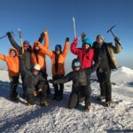 Happy climbers on the summit of Mt. Rainier (Andy Polloczek)